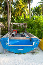 A boat on a beach in maldives Stock Photo