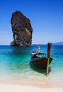 Boat on the beach at phuket island tourist attraction in thaila is an international magnet for lovers and serious divers andaman Stock Photos