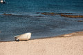 Boat on the beach small in almeria spain Stock Photo
