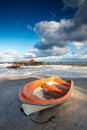 Boat on the beach at sunrise time baltic sea Royalty Free Stock Photography
