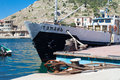 Boat in berth balaklava bay famous foreland on south shore of crimea resort ukraine Stock Image