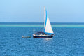 Boat on blue ocean water Royalty Free Stock Photo