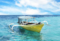 Boat and blue water ocean yellow Royalty Free Stock Photos