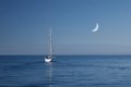 Boat in the calm sea with moon sky Royalty Free Stock Image