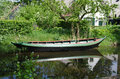 Boat in canal nice a Royalty Free Stock Photo