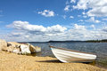Boat on coast of lake coastal landscape with white the finland Stock Photo