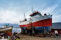 Boat on a coast. Moored boat on a pier. Royalty Free Stock Photo