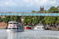 Boat cruises along picturesque river dee chester county cheshire england Stock Photo