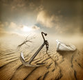 Boat in the desert anchor and dry tree Royalty Free Stock Image