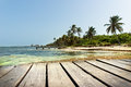 Boat dock in the caribbean sea close up of a and others seen distant background Stock Photo