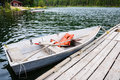 Boat at dock in lake old row with life jackets and oars moored to copy space Royalty Free Stock Image
