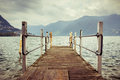 Boat dock in lugano switzerland nautical travel european vacation boating and yachting concept high contrast vintage processed Royalty Free Stock Photography
