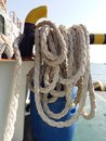 Boat dock and rope. Royalty Free Stock Photo