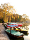 Boat the docked at the lakeside dock in autumn the photo was taken in november Royalty Free Stock Photo