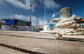 Boat docking point at a marina rope fixed around a belay in small harbor Royalty Free Stock Image