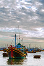 Boat evening fishing the trawler with boats in a bay on a sunset Royalty Free Stock Images