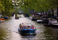 Boat excursion through the canals in Amsterdam Royalty Free Stock Photo