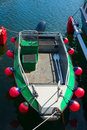 Boat with fenders small motorboat in harbor lots of red Royalty Free Stock Image