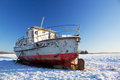 Boat on ground in winter Stock Images