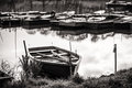 Boat harbour in black and white wood boats on the lake Stock Photography