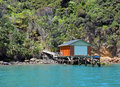 Boat house in the marlborough sounds new zealand classic and jetty on rocky shores of Royalty Free Stock Images