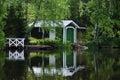 Boat house reflecting on lake Royalty Free Stock Photo