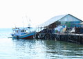 Boat by a house in Sorong Royalty Free Stock Photo