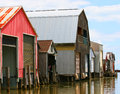 Boat houses colorful with blue sky and white clouds Royalty Free Stock Image