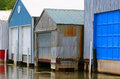 Boat houses colorful with blue and white doors Royalty Free Stock Images