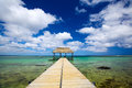 Boat jetty calm scene with and turquoise water in mauritius Royalty Free Stock Photo