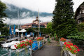 Boat jetty a at the rear of a hotel in darligen switzerland on lake thun Royalty Free Stock Photo