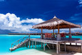 Boat jetty with steps on a tropical island of maldives into water Stock Image