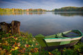 Boat and lake alone near in autumn Stock Image