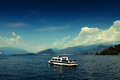 Boat on lake the great lago maggiore with mountains in the background north of italy Stock Photos