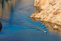 Boat leaving waves in Zrmanja river canyon Royalty Free Stock Photo