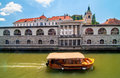 Boat on Ljubljanica river and St. Nicholas church in the backgro Royalty Free Stock Photo