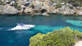 Boat in majorca coast white small navigating the turquoise waters nature Stock Photography