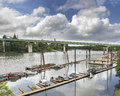 Boat moorage along willamette river in oregon city with i freeway on george abernethy bridge Stock Photos