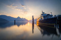 Boat moored on lake lucerne scenic view of at sunset nidwalden switzerland Stock Photos