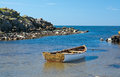 Boat moored in a tranquil bay Royalty Free Stock Photo