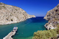 Boat moored in vathy fjord scenic view of a at the end of a pier vathi on kalymnos island dodecanese islands greece Royalty Free Stock Photography