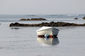 Boat on a mooring small at goose rocks beach kennebunkport maine Stock Image