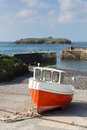 Boat in Mullion Cove harbour Cornwall UK the Lizard peninsula Mounts Bay near Helston Royalty Free Stock Photo