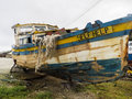 Boat named self help dilapidated fishing at tent bay on the east coast of barbados Stock Photo