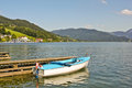 Boat near pier on alpine lake mondsee austria Royalty Free Stock Image
