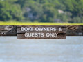 Boat owners sign a reading guests only Royalty Free Stock Photography