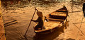 Boat paddler golden hour Royalty Free Stock Photo