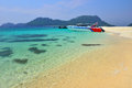 Boat parks on a beautiful beach at lipe island Stock Photos
