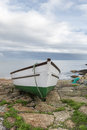 Boat at penberth cove in cornwall a green and white fishing Royalty Free Stock Images