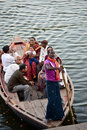 Boat with people a indian in varanasi on the river ganga Stock Photos